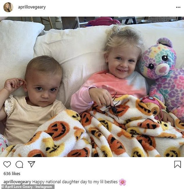Lil besties: April Love Geary, 25, shared a photo of daughters Mia, two, and Lola, one, writing: 'Happy national daughter day to my lil besties'