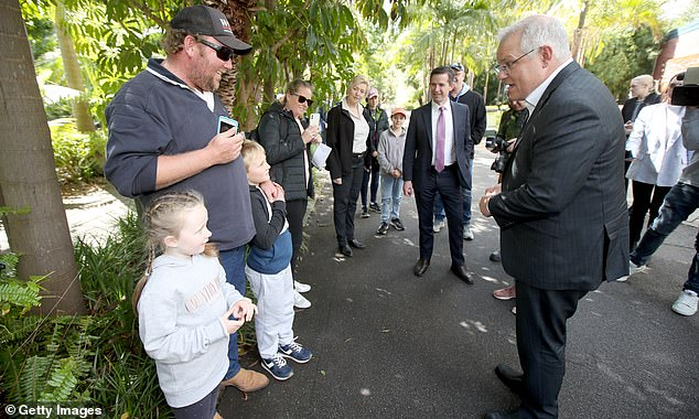 Mr Morrison speaks with zoo visitors during a visit to the Adelaide Zoo on September 26, 2020