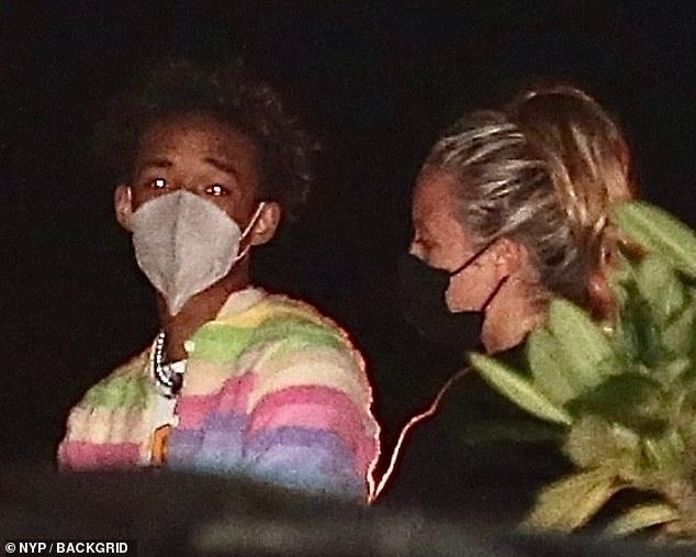 Cool:Jaden, meanwhile, showed off his individual style in a rainbow striped jumper and a white slogan T-shirt