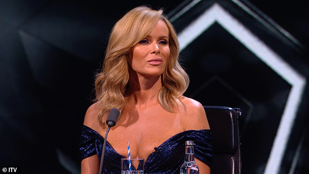 Moved: Meanwhile, Amanda Holden, 49, who looked stunning in a plunging blue gown, is seen nodding along to the music as she watched