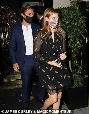 The royal (pictured with her husband) teamed the eye-catching garment with a matching pair of shoes, while boasting a smattering of glamorous makeup