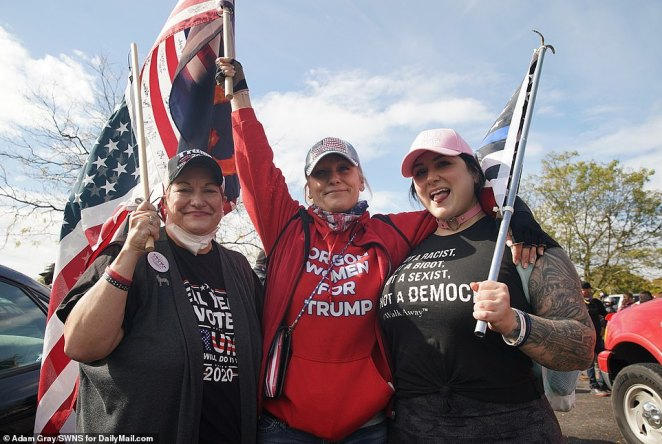 Dozens of people waving MAGA flags and decked in Proud Boys merchandise arrived early for the right-wing rally Saturday