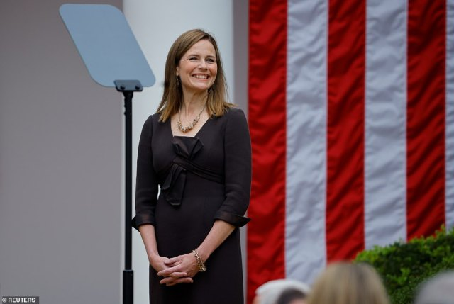 Judge Amy Coney Barrett smiles as she's nominated to the Supreme Court Saturday in Washington, D.C.