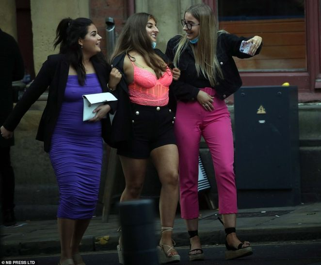 Three women smile as they take a selfie in Leeds as they head into town ahead of the new 10pm curfew introduced to slow the spread of the coronavirus
