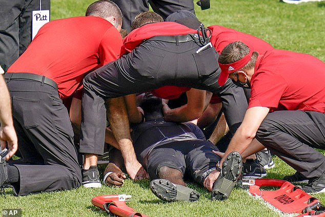 Trainers tend to Louisville quarterback Malik Cunningham (3) after he was injured