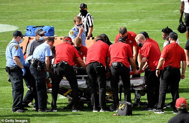 Malik Cunningham #3 of the Louisville Cardinals is loaded onto a stretcher after being injured on a play in the fourth quarter during the game against the Pittsburgh Panthers at Heinz Field