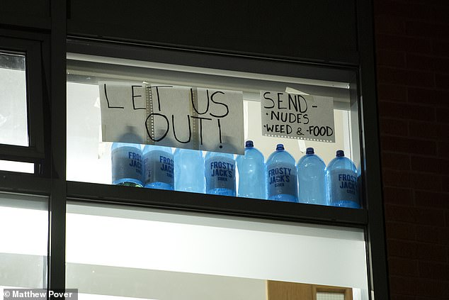 Students display signs in windows at Manchester Metropolitan University's Cambridge Halls