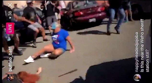 'Oh my God!' a woman is heard screaming on video as the white Nissan Versa accelerates into the crowd, knocking the demonstrators to the pavement