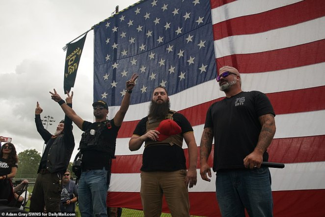 Proud Boy organizers take the stage at a right-wing rally on Saturday, amid fears of violent clashes with counter-protesters