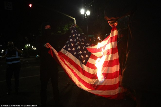 Black Lives Matter protesters burned the American flag in Portland, Oregon