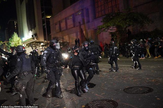 Portland police arresting BLM supporters outside of Justice Center in Portland, Oregon