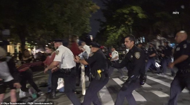A dramatic scene unfolded late Saturday between a group of protesters and police steps away from an outdoor dining establishment in the West Village