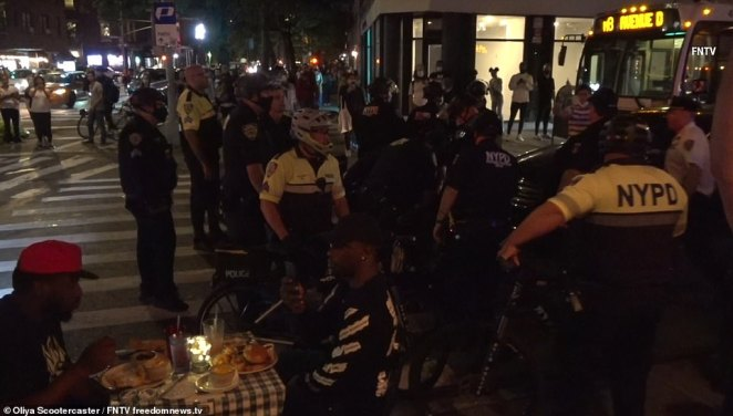 The scuffle and subsequent arrests took place just feet away from where people were dining out and enjoying burgers