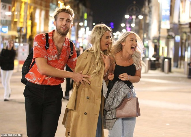 These revellers were all smiles as they headed for a night out in Leeds city centre ahead of them 10pm curfew being imposed