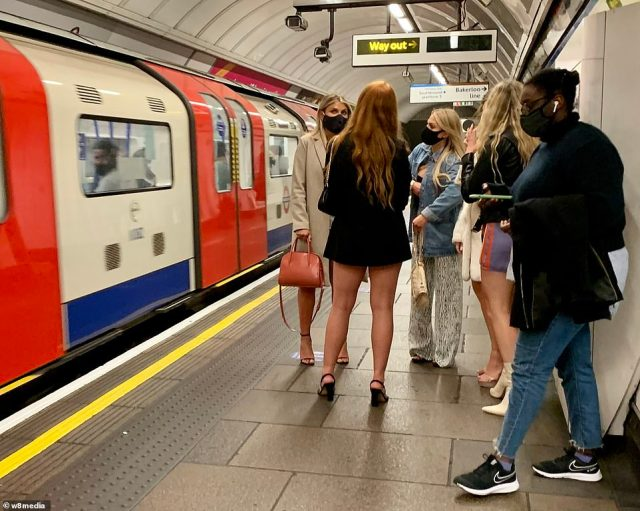 Mask-clad partygoers were seen standing on a platform in the London Underground after the 10pm curfew kicked in