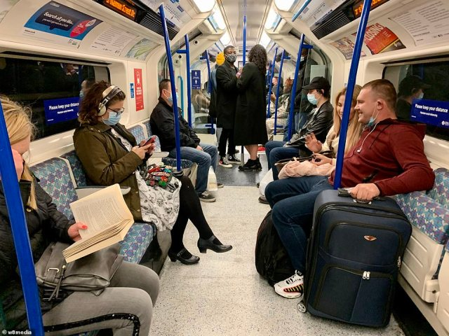 People were gathered on the tube in London after the 10pm curfew. Many opted for public transport as Uber prices surged