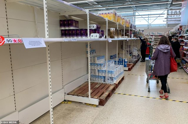 And online customers found it near-impossible to get delivery slots from Asda, Morrisons, Ocado, Sainsbury's and Tesco - some didn't have free slots for up to two weeks. Pictured: Empty shelves at a Tesco in Cambridge