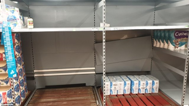 An Asda in east London had its shelves stripped bare of essentials like toilet paper