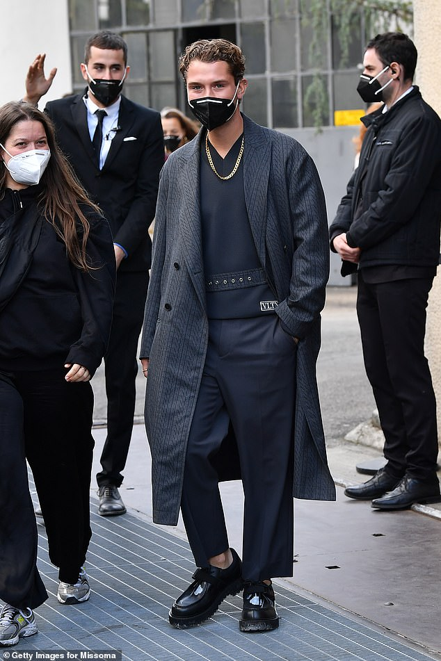 Safety first: The London-based performer was seen to don a face mask as a result of the ongoing pandemic