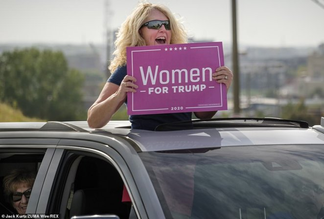 A member of Women for Trump is seen holding a sign in support of Trump on Saturday