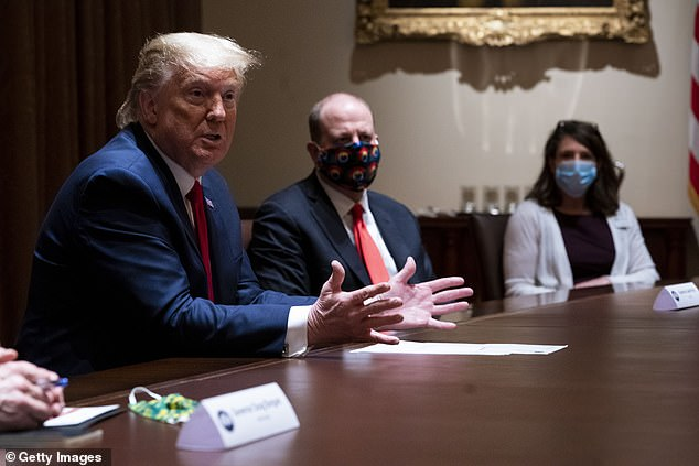 The campaign will reportedly cast the Trump administration's handling of the COVID-19 pandemic in a positive light. Trump pictured May 13