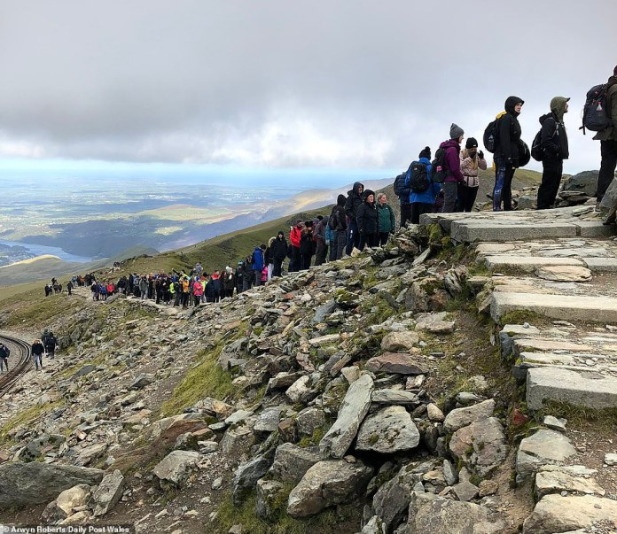 Walkers in their climbing gear meandered up and down the mountain in an effort to reach the top of Mount Snowdon which is in Snowdonia National Park