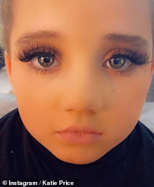 Cute: The former glamour model's child wore foundation, glittery eyeshadow and eyelash extensions