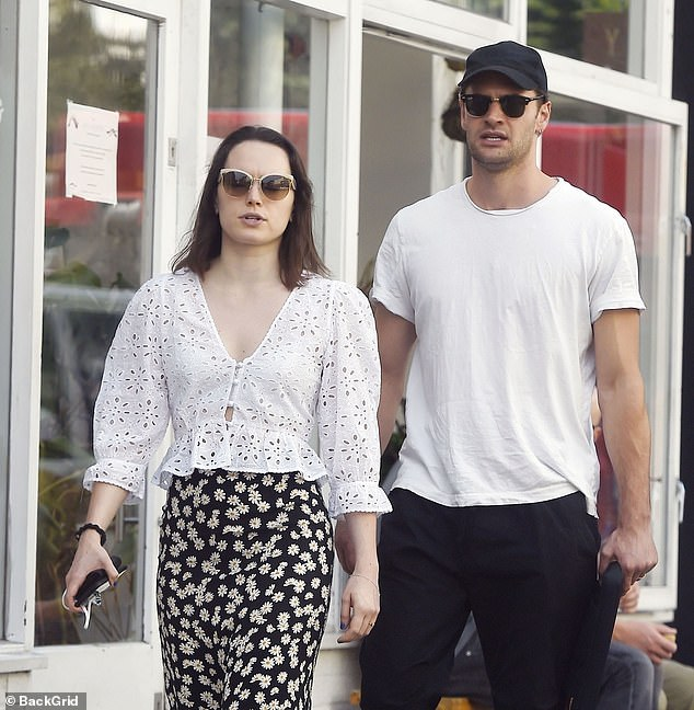 Casual: The couple both opted for sunglasses and white tops