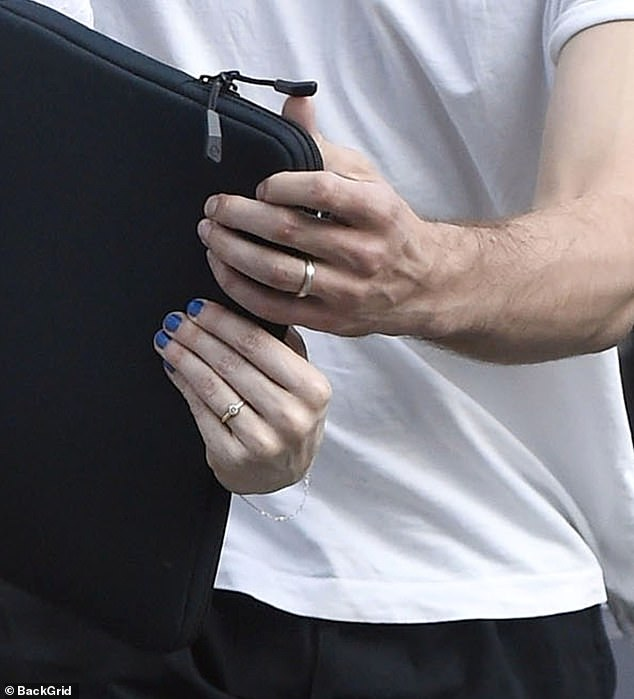 Together: Both Daisy and Tom were seen with gold bands on their wedding fingers, with the actress' boasting a diamond in the centre