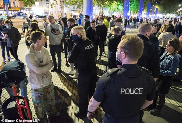 Signalling a tough crackdown, Home Secretary Priti Patel warned last night that ministers 'will not allow those who break the rules to reverse the hard-won progress made by the law-abiding majority'. Pictured: Police attempt to disperse crowds gathered in London