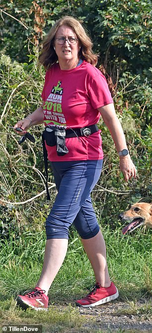 Run:Miss Smith, 57, went for a run with her two lurchers Ronan and Lori near her home in Worcestershire