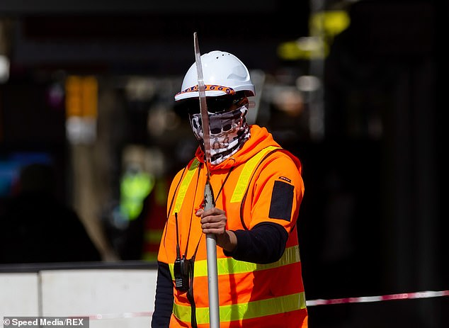 The federal government has extended the $86billion scheme until March but is gradually reducing the payments to wean the economy off support. Pictured: A tradie in Melbourne