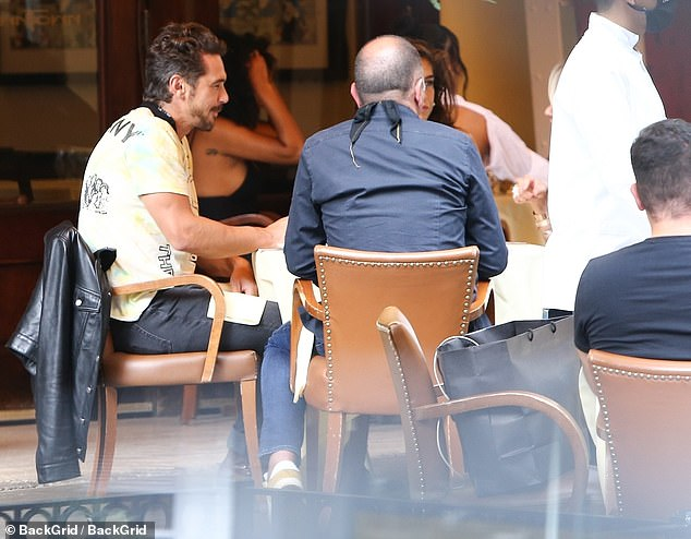 Work lunch: Franco looked as if he might have business to discuss at the lunch, as he brought along a large black notebook stuffed with pens
