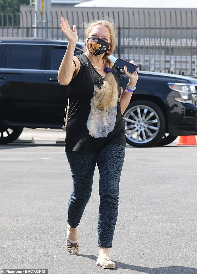 Meow! Tiger King star Carole Baskin wore a cat T-shirt with cat shoes and a cat-themed mask on her way inside rehearsals