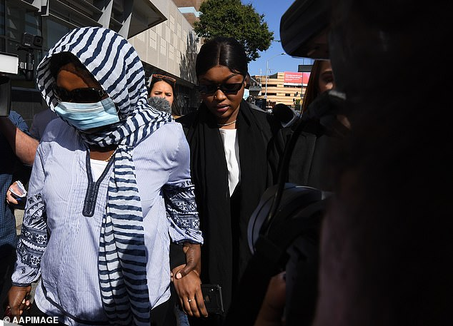 Diana Lasu (centre) was granted a bail extension on Monday when she appeared in court