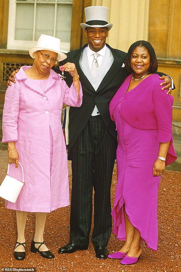 Hard: Earlier this year, the football legend recalled how his brother masked his mother's cries as she was assaulted by his stepfather (pictured with his mum and then-wife Debbie in 2000)