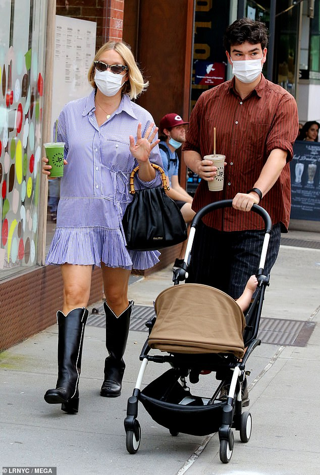 Stylish star: Sevigny showed her fashionista credentials in a blue shirt dress paired with black cowboy boots. She had on statement sunglasses along with a disposable face mask