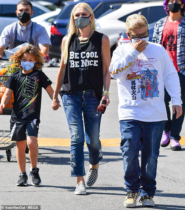 Punk mom: Gwen Stefani stayed true to her punk roots Sunday in a sleeveless black t-shirt and Vans, as she enjoyed a trip with sons Kingston, Zuma and Apollo at a pumpkin patch in the Encino neighborhood of Los Angeles