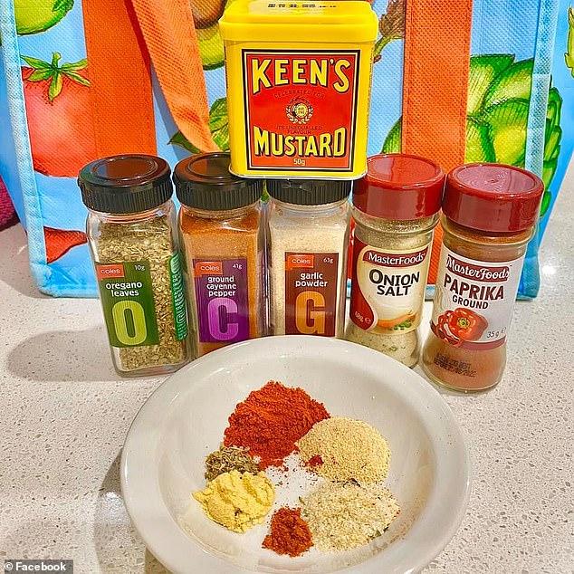 Sara mixed paprika, garlic powder, mustard powder, onion salt, dried oregano and cayenne pepper in a bowl to coat onto the pork strips
