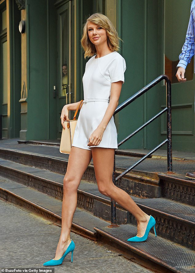 Gunshots were fired for the second time this month during an armed robbery of a sneaker store located right next door to Taylor Swift's townhouse in the trendy Tribeca section of Manhattan on Sunday evening, it has been reported. Swift is seen above walking out of her Tribeca apartment in this May 2015 file photo