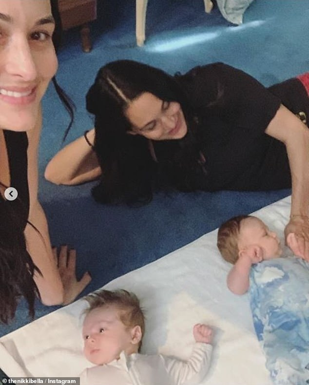Twin pregnancies: She gave birth just a day before twin sister Brie Bella, 36, welcomed her own son Buddy Dessert, one month, also sharing daughter Birdie Joe, three, with husband Daniel Bryan, 39