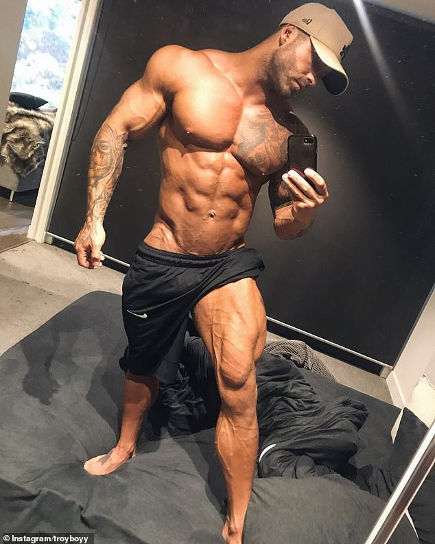 Almost unrecognizable! Troy looks very different to what he did on the show as he is now a muscly, tattooed personal trainer