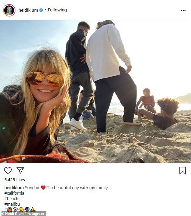 She later took to the side sharing a post from a trip to the beach as she relaxed with the Tokio Hotel guitarist and her kids