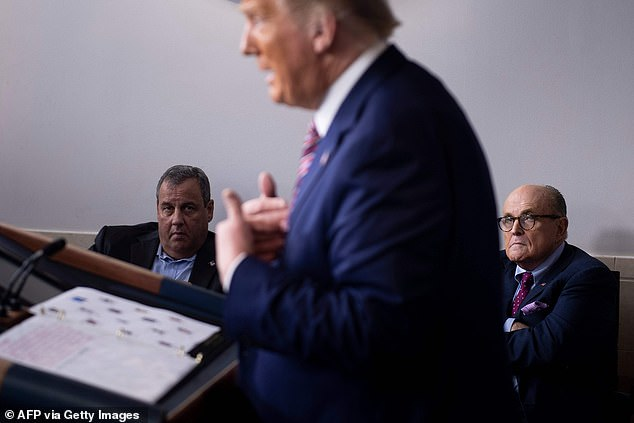 'We're doing it. These two gentlemen have been helping,' Trump said before adding that both men were 'about five times smarter than' Biden.