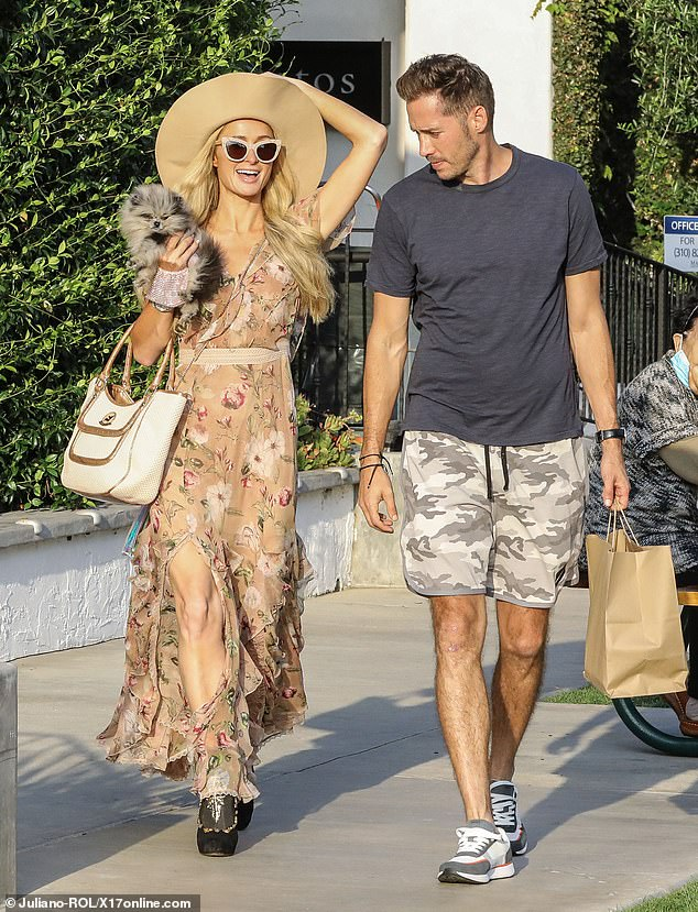 Shopping trip: Paris Hilton and beau Carter Reumwere snapped out and about in Malibu on Sunday as they ran some errands together along with the hotel heiress's Pomeranian pup