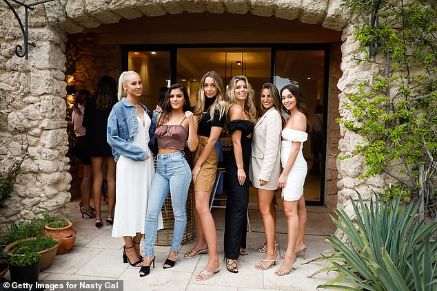 Making it happen: Bella [far R] got comfortable in a group shot with some of Australia's well-known 'influencers'. Pictured L-R, Amy Hembrow, Starlette Thynne, Sammy Robinson, Natasha Oakley, Jade Tuncdoruk and Bella