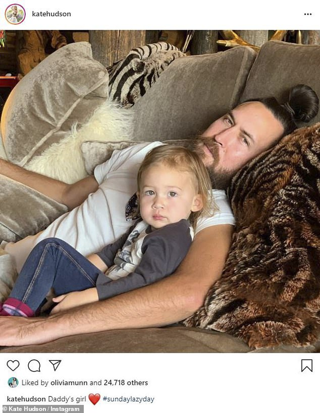 Daddy's girl: Kate Hudson took to Instagram to share a sweet snapshot of beau Danny Fujikawa, 34, and their darling one-year-old Rani Rose on Sunday evening