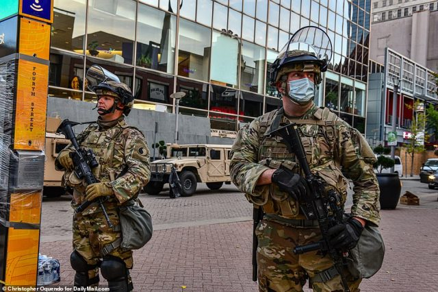 Heavily-armed officers were out in force earlier on Sunday as the city braced for another night of protests