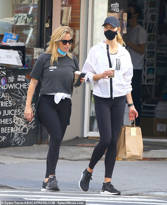 Casual:Karlie also sported a pair of black trainers and put safety first as she wore a matching face mask while running errands