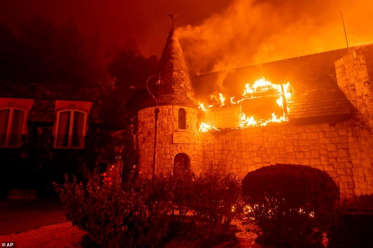 Chateau Boswell's roof was in flames as the blaze ripped through the region in the latest terrifying wildfire